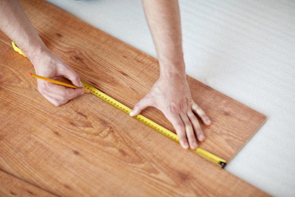 someone measuring the wood